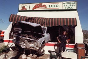 ME.Drive Thru.1.0305.RM.3 Burbank Police officer Larry Hill at the scene where a runaway truck backed through the front of El Burrito Loco, at Victory and Burbank Blvds in Burbank. The truck crossed two streets before plowing backwards into the restaurant. Two occupants of the truck suffered minor injuries. Half dozen people, both inside and out, were injured in the morning crash. Rick Meyer/LAT WED FOLDER also moved to ART FOR SFV. Mandatory Credit: Rick Meyer/The LA Times